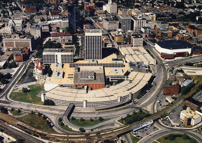 """Symbol #2 of the automobilization of Worcester: The Worcester Center Galleria completed in 1971, greeted train passengers with a  huge  parking garage. Now, there was no pedestrian access from Union Station to the core of downtown. The mall was ringed by Foster Street widened into a four lane """"highway"""" that was almost impossible to cross. The message was clear: This city was now going to be designed for cars, not pedestrians or train-goers. The mall also helped kill the street life in the rest of downtown. Now, people could drive, shop and then leave without ever stepping foot on a downtown outdoor sidewalk."""