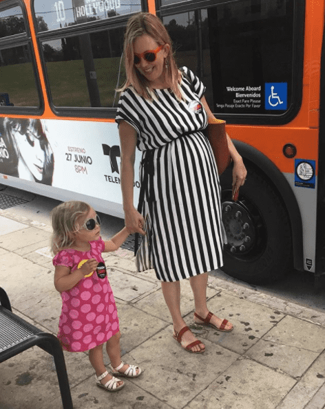 Alissa and her daughter about to hop on the bus