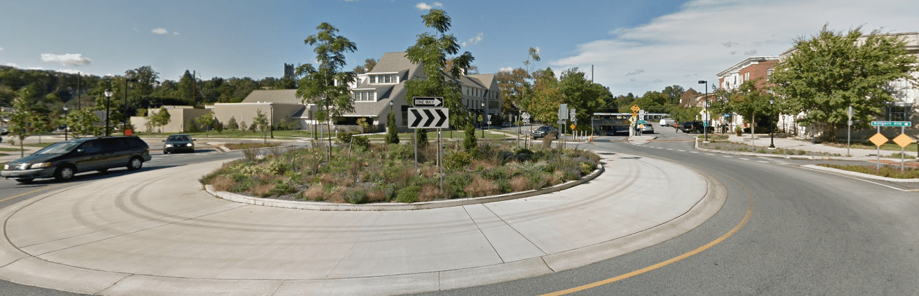 The same intersection, after the roundabout was constructed. The Inn at Swarthmore is on the other side of the roundabout, and the businesses on Chester are across the roundabout. Swarthmore College lies to the left of the roundabout. (Source: Google Maps)