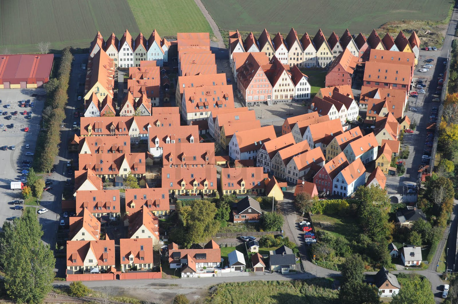 Jakriborg, Sweden was built following this basic pattern in the 1990s and has been growing slowly and organically since then. (Source:  hjarup.nu )