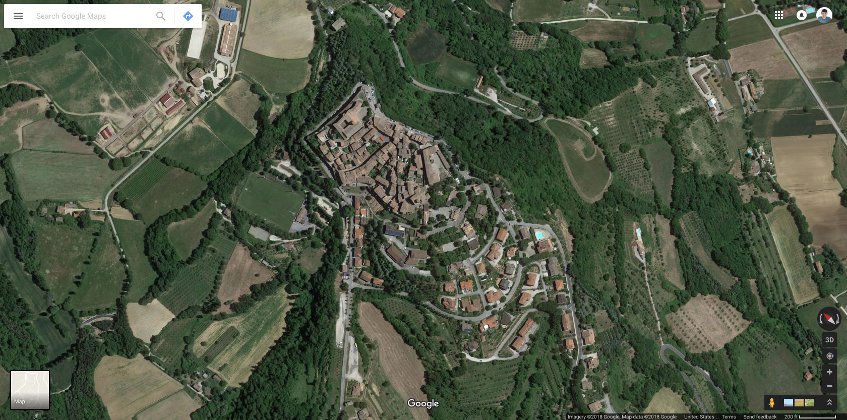 Montone, Umbria, Italy. No fancy transit. They have a bus that comes to the edge of town, otherwise there are parking lots around the outskirts. (Source: Google Maps )
