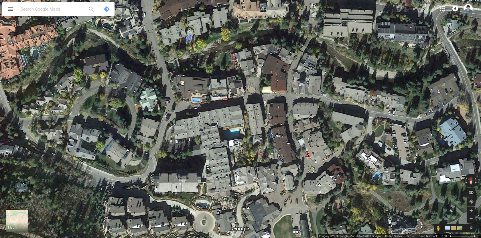 Aerial view of Vail with parking lots scattered around the edges. ( Google Maps )
