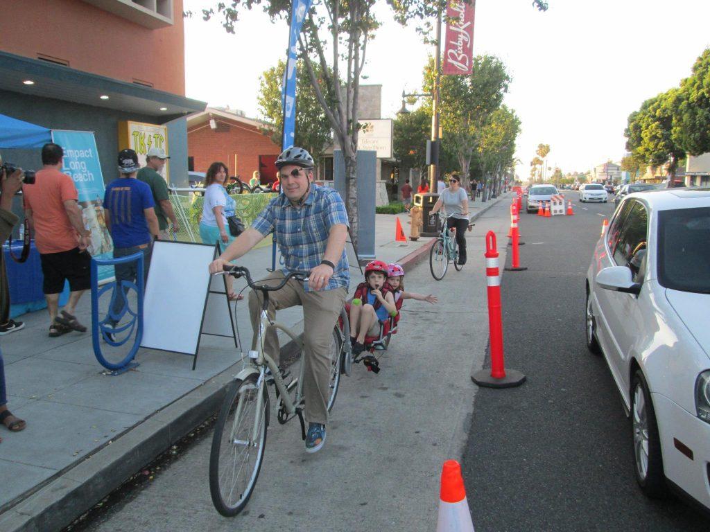 A temporary bike lane helps narrow a street and create safer transportation options (Source:  Bike Long Beach )
