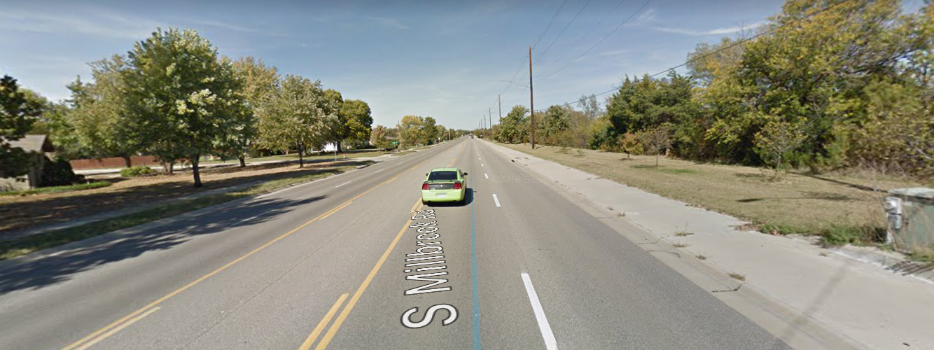 Wide, straight, featureless roadways like this one (119th Street/Millbrook Rd between Kellogg and Maple in Wichita) lull drivers into a false sense of security, increasing risky driving behaviors. (Source: Google Maps)