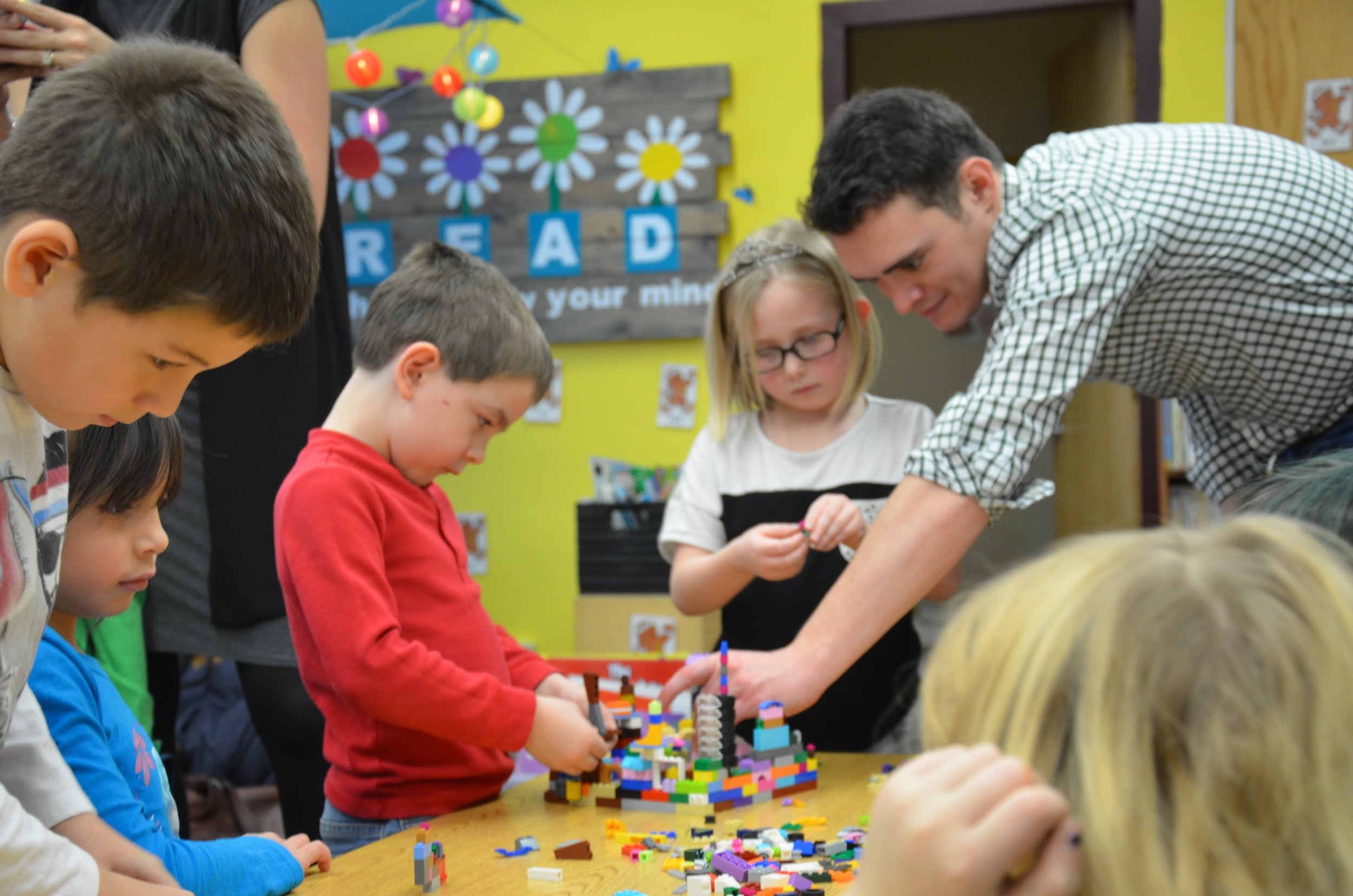 Architect Mitchell Borgen works with kids at a local elementary school to talk about planning. (Source: Jonathan Holth)