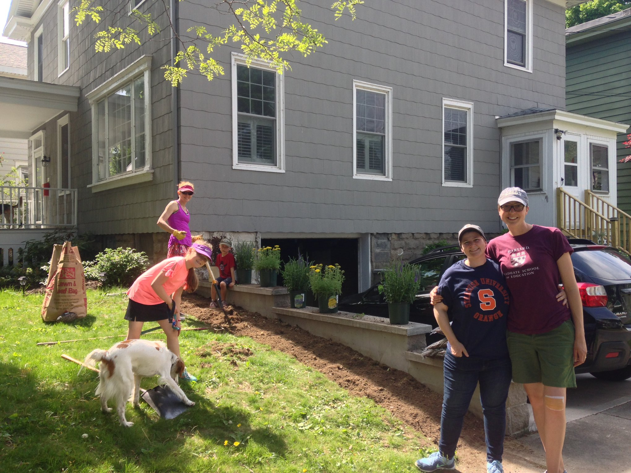 New Oswego homeowners Kristi Eck and Liz Eck joined with neighbors in leading the efforts for beautification of their street. (Source: Oswego Renaissance Association Facebook page)