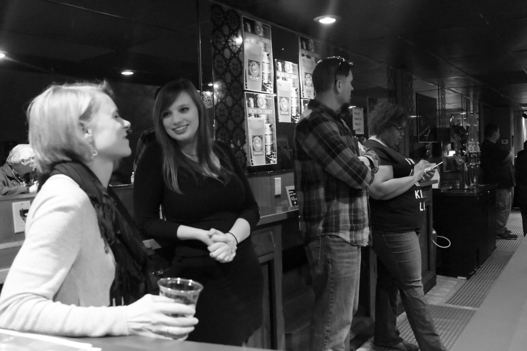 Akron residents enjoy a night out at the Live Music Now! pop-up space.