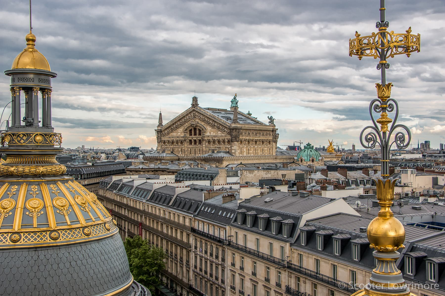The classic roof design on Paris buildings is partly the result of taxation laws created in the 17th century. (Source:  Scooter Lowrimore )