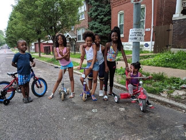 The simple act of closing a street for a few hours offers a world of possibility for residents to re-envision the use of public space in their neighborhood — and have fun while doing it. (Source: Open Streets STL)