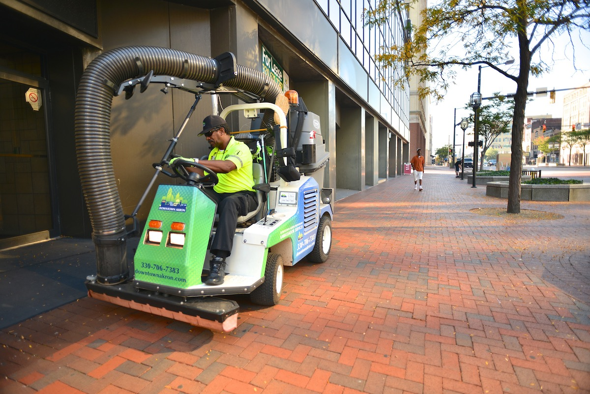 """""""Ambassadors"""" from the Downtown Akron Partnership help with street maintenance."""
