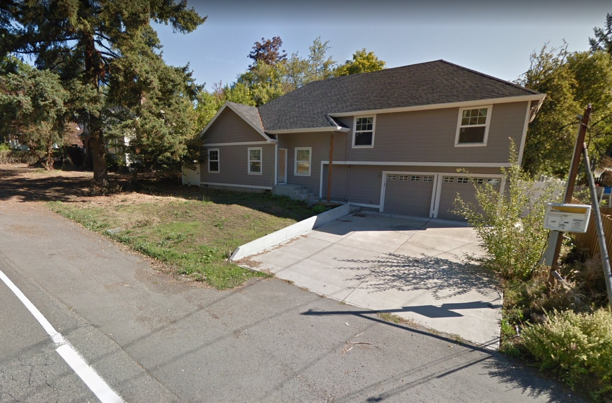 A house built in 2015 on Southwest Capitol Hill Road, a five-minute walk from a proposed rail station. When this is the only sort of home that's legal, it's the only sort of home we'll get. Photo by Google Maps.