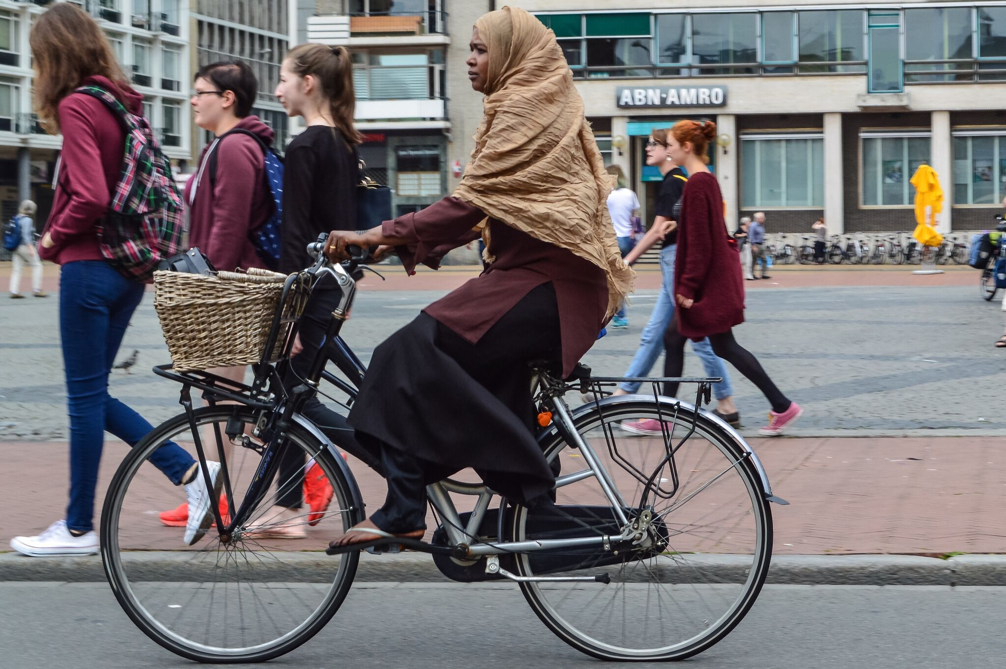 A woman using a bike as transport in the Netherlands. (Courtesy of Chris and Melissa Bruntlett)