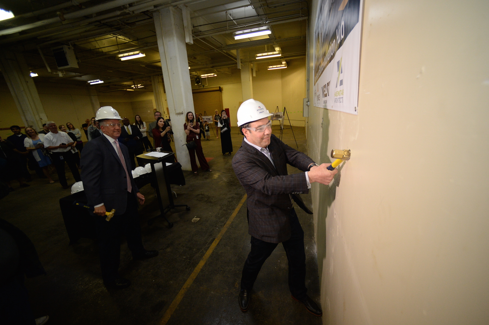 First floor wall-breaking ceremony with Doug Weintraub and Akron mayor Dan Horrigan