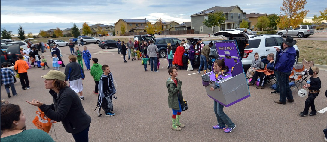 Kids fill a parking lot Trunk-or-Treat event at Schriever Air Force base. Photo credit: Schiever Air Force Base.