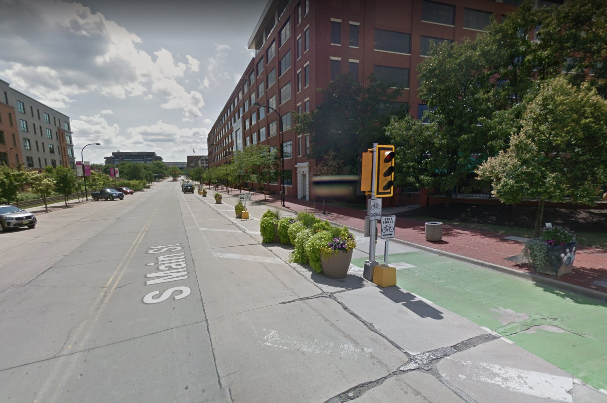 A protected bike lane on South Main Street has become an accepted feature of the streetscape. (Image: Google)
