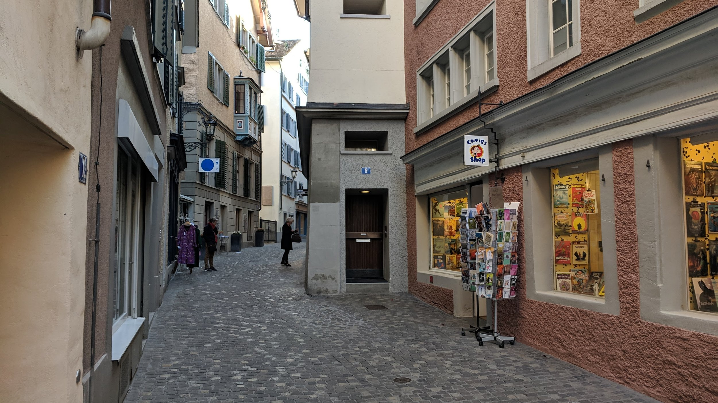 A street in Zurich, Switzerland that suddenly narrows because a building sticks out into the street further than its neighborhood.