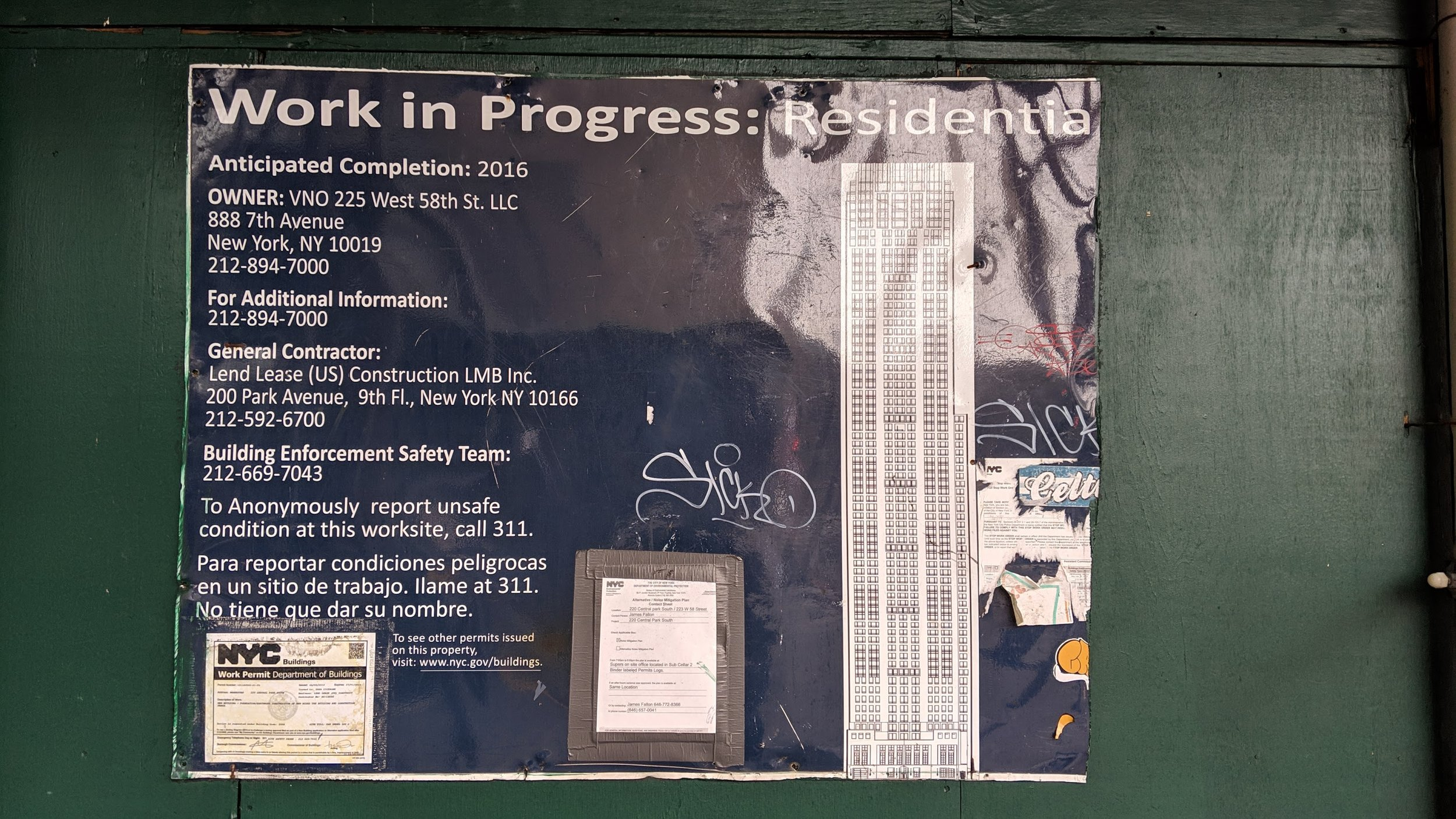 A  Work in Progress  sign posted on the outside of a construction site.