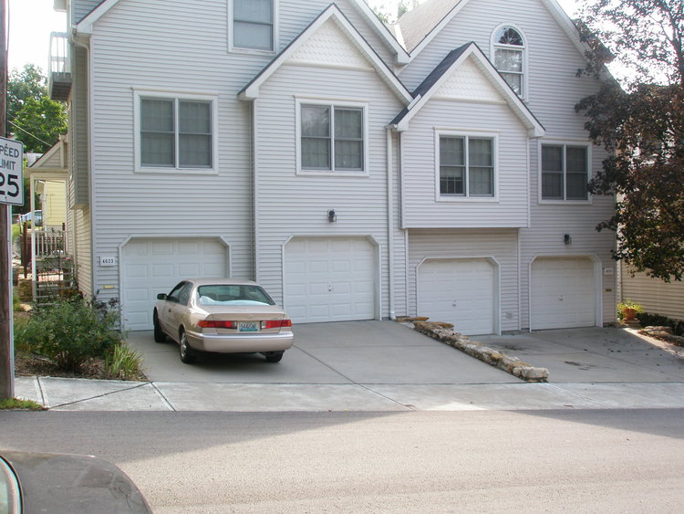 Say no to this type of garage/parking placement [which destroys value by ruining the integrity of the streetscape].
