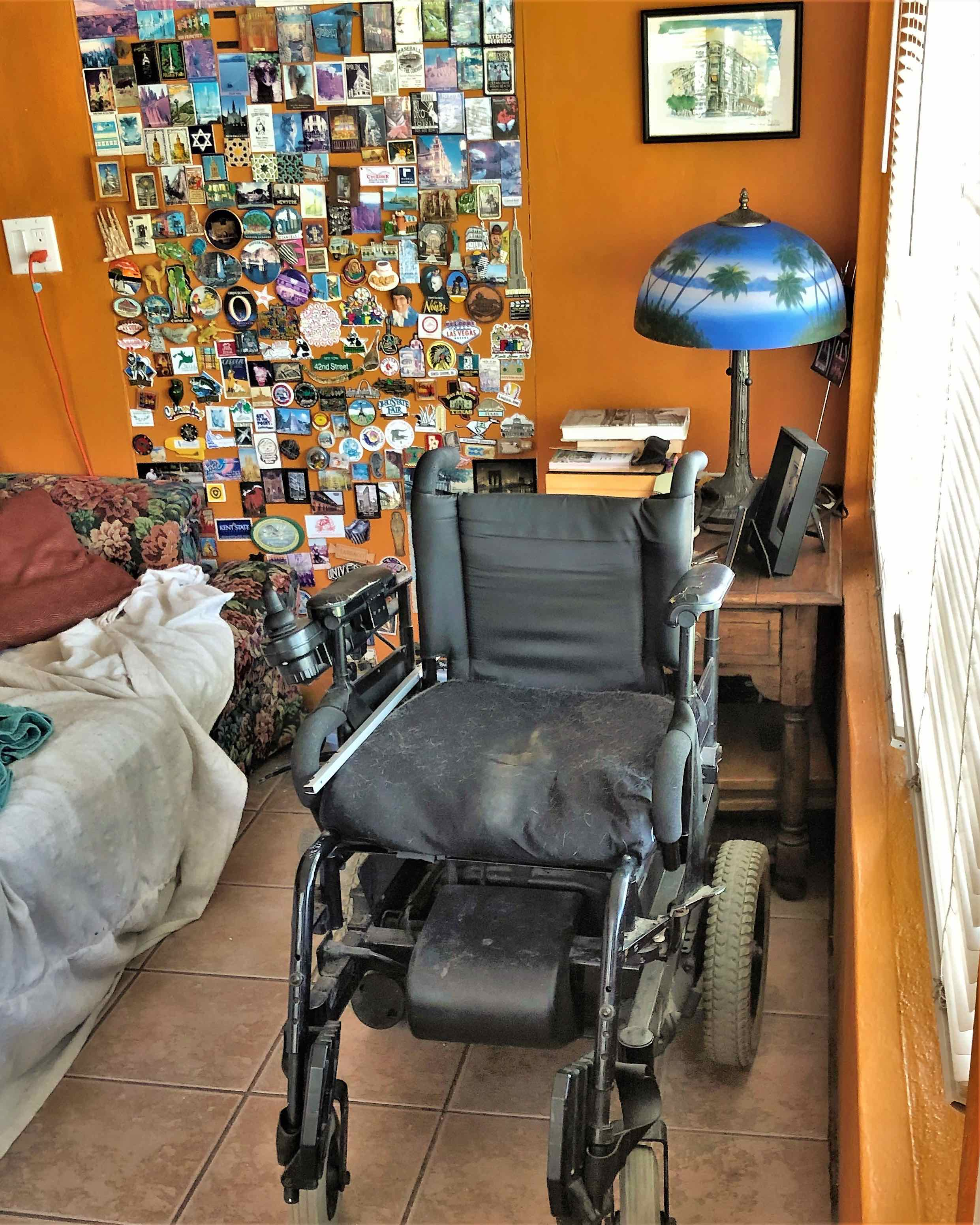 Reacher in wheelchair makes it easy to plug in for charge. Tropical colors brighten a room in our 100 year old house.