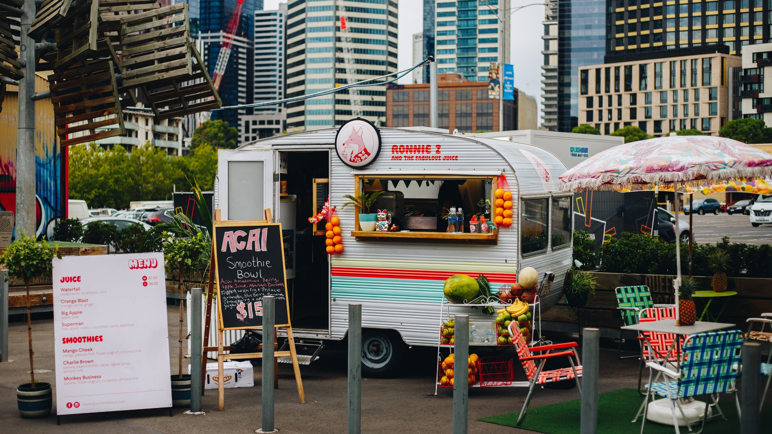 Food truck parks provide small-scale entrepreneurs with a lower barrier to entry to the market and enhance the community's quality of life by providing greater variety. Source:   Isaac Benhesed