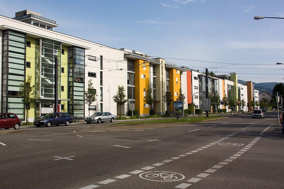 Main thoroughfare in Quartier Vauban, opposite the light rail line. ( Image source .)