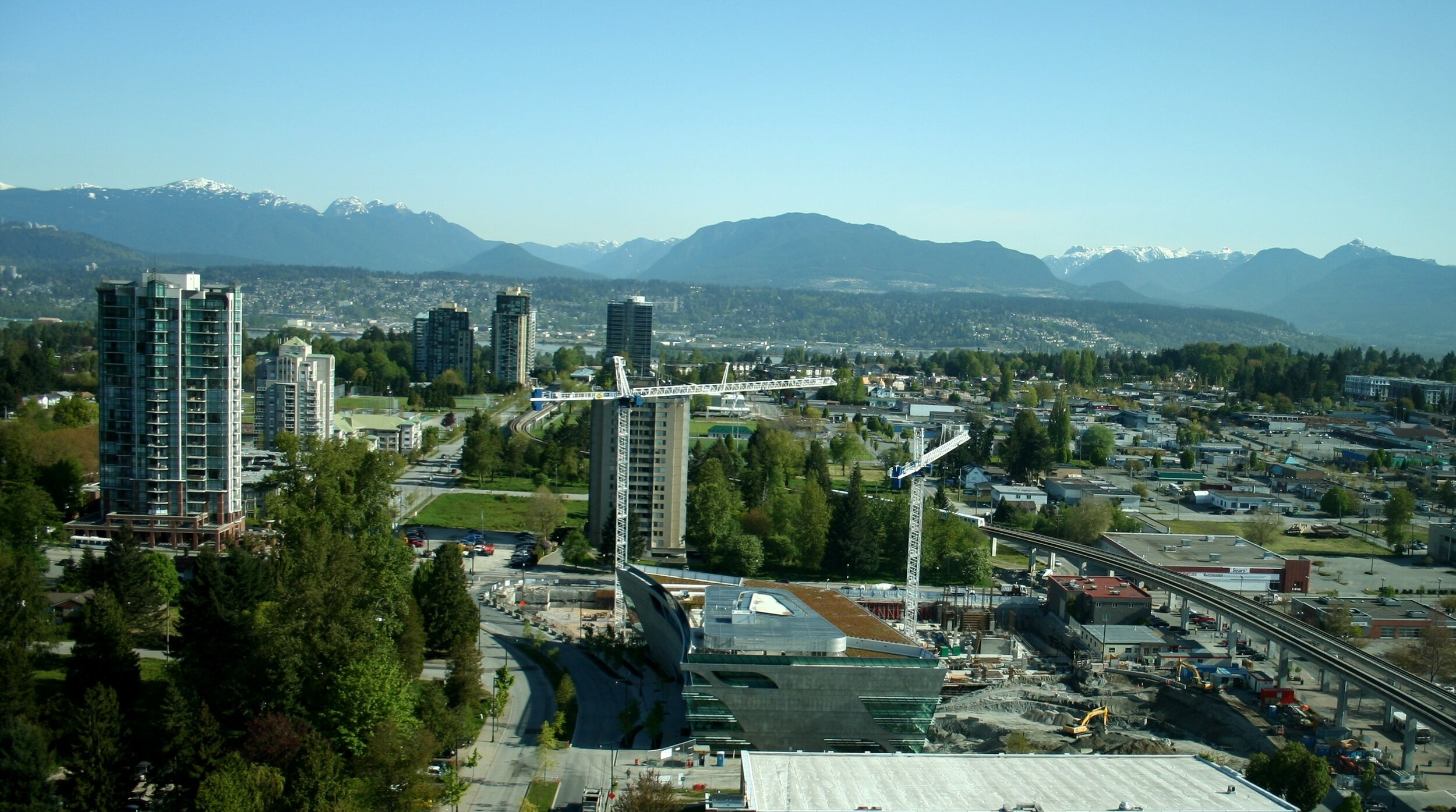 """""""Spiky"""" transit-oriented development rises amid low-rise suburbia, outside Vancouver, BC. (Source: Wikimedia Commons)"""