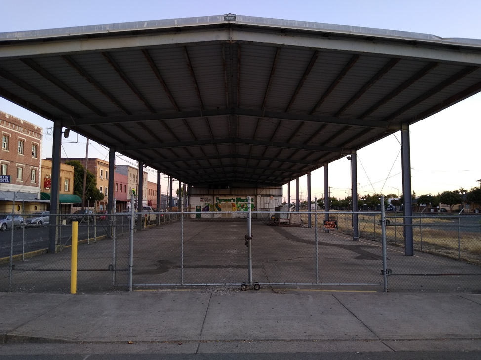 This 10,000-square-foot packing shed could do more than store agricultural machinery downtown, such as serving as a year-round farmer's market referenced in the mural at the far end. Source: Doug Bojack
