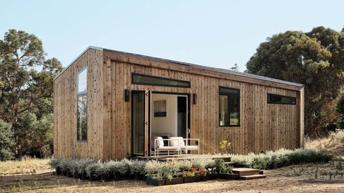 Prefabricated ADU displayed in the environment it was designed for.