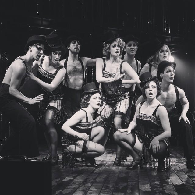 "Kit Kat Club dancers performing in ""Money"""