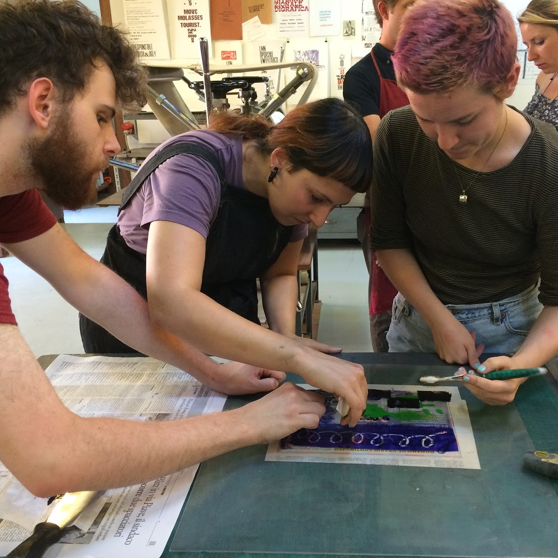 Students Adam Gowan and Brianne McKain at work in the print shop with assistant Roberta.