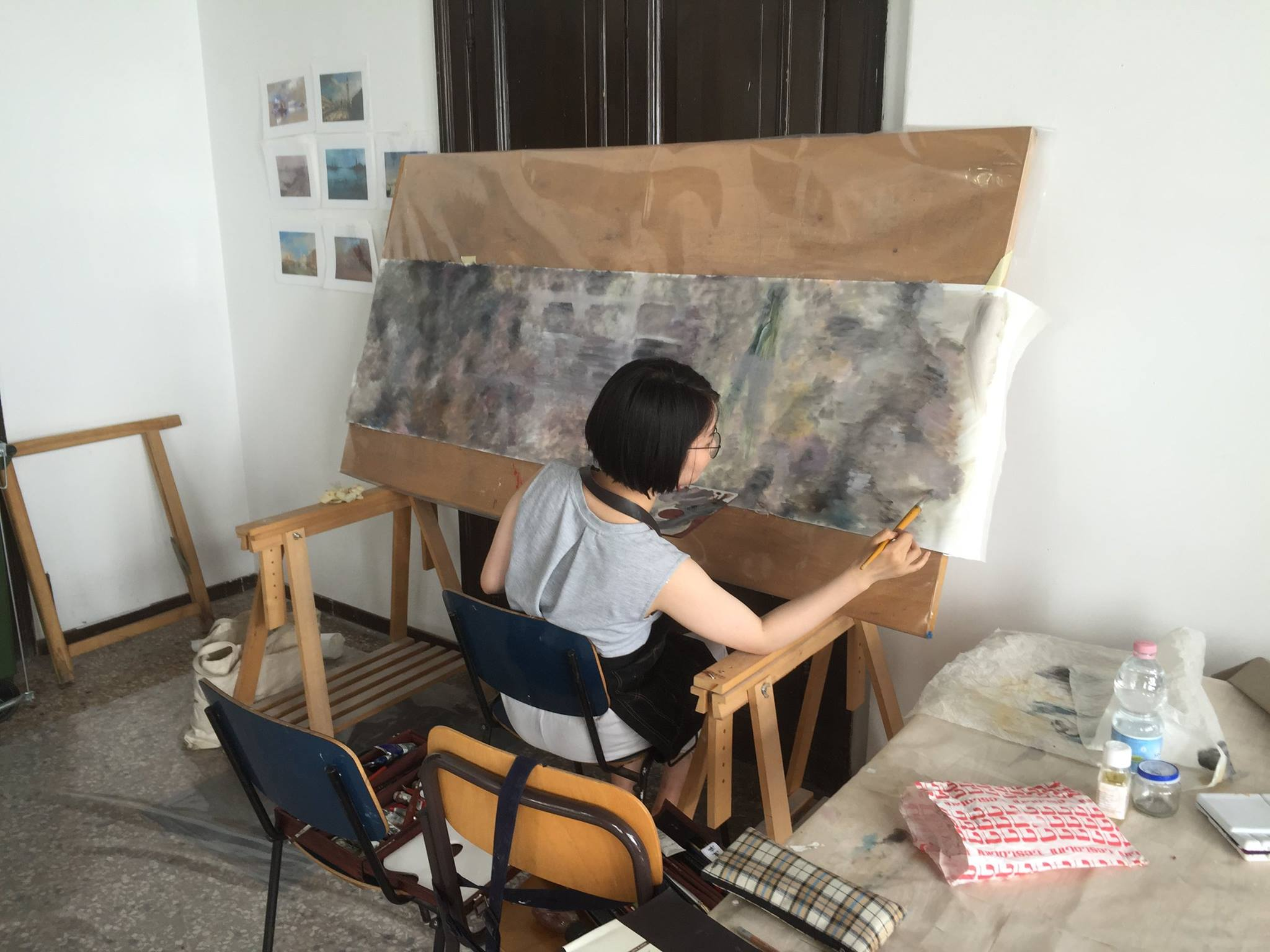 Painting student Yawen Hu working in the studio at UIA.