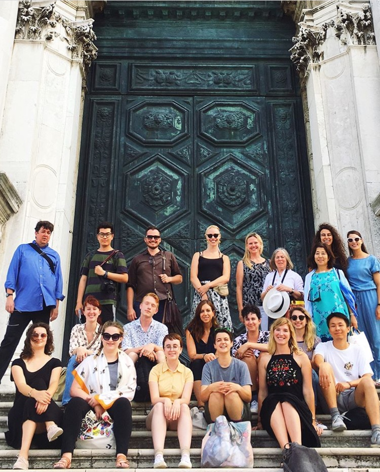 Faculty and students (with alumna Monique Rollins) at Santa Maria della Salute, July 2018.  Back row, left to right: Michael Brennan (Painting Professor), Penghui Zhang, Joseph Kopta (Art History Professor), Michele Rushfeldt, Monique Rollins, Diana Gisolfi (Director and Professor of Materials and Techniques), Aomi Kikuchi, Chantal Kassarjian, Jenna Pasquino.  Middle Row: Thea Zwier, Christian Harding, Andrea Santos (Printmaking Professor), Alessandra Levato, Skyler Elfeldt, Xingze Li.  Front row: Abby Staub, Kirsten Herman, Olivia Cranney, Drue Schwartz, Aubrey Roemer.