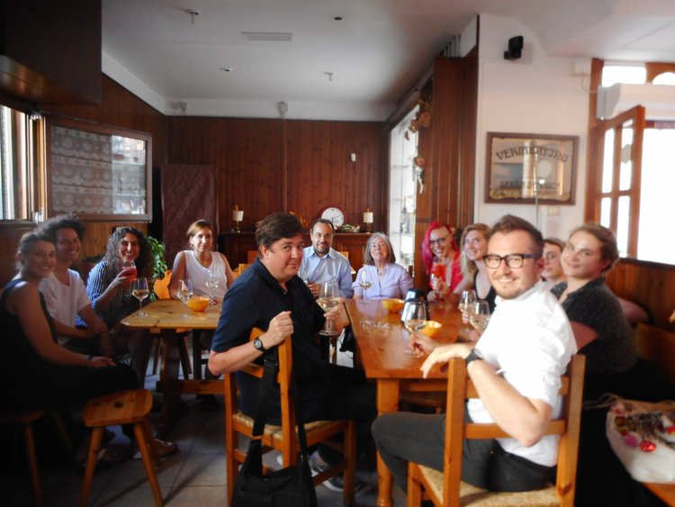 Students and faculty celebrate after successful Materials & Techniques and Art History presentations at the conclusion of the program, July 2018.