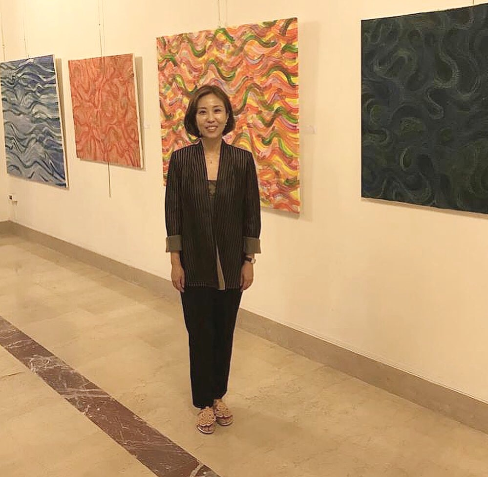 Hye won Hahn with her exhibited paintings in the US Embassy in Rome.