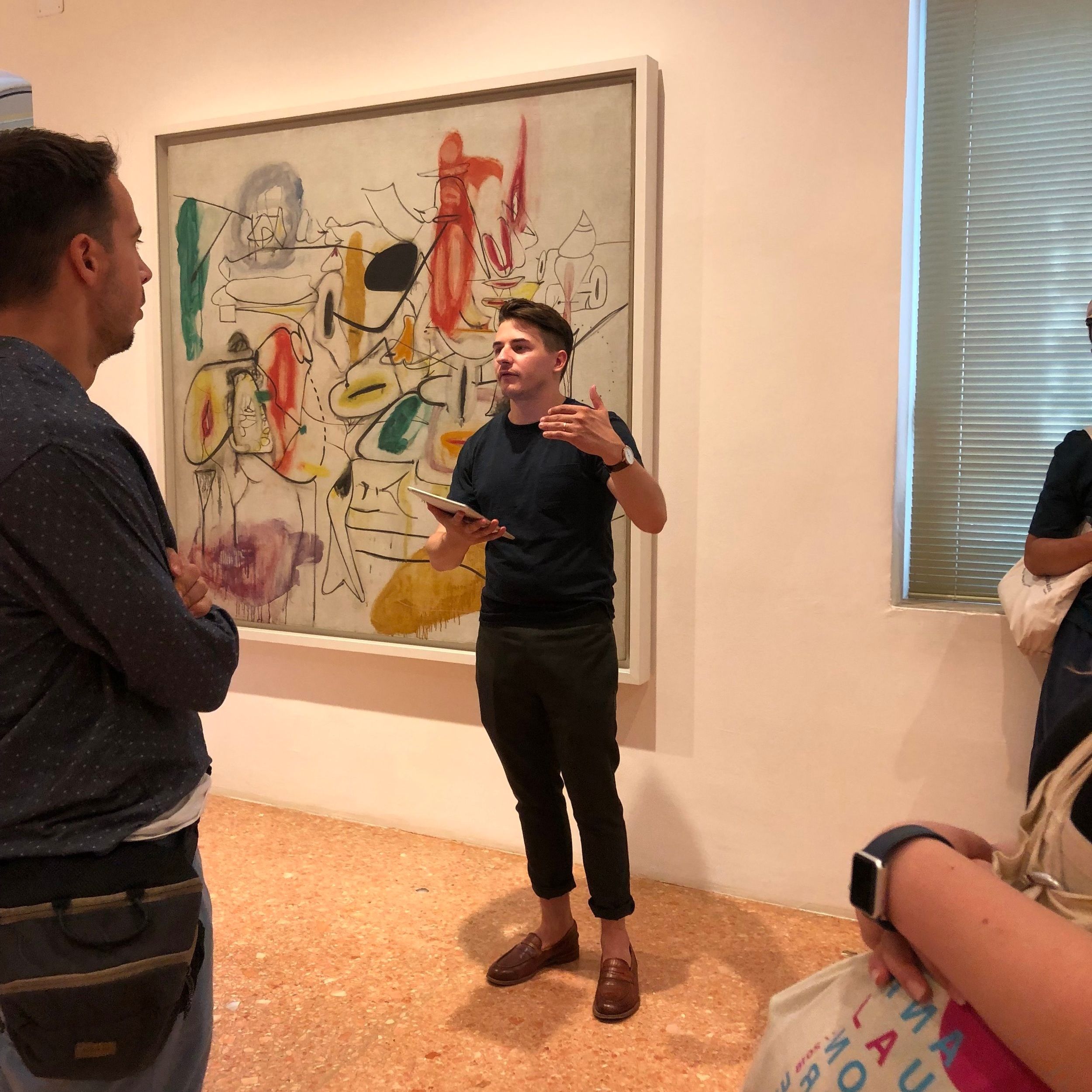 Andrew Kurczak guides students through the Collection's Abstract Expressionist gallery, including Arshile Gorky's  Untitled  (1944).