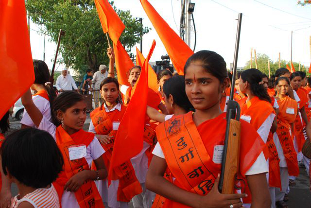 Chinmay, 14, holding a rifle on graduation day at the Durga training camp
