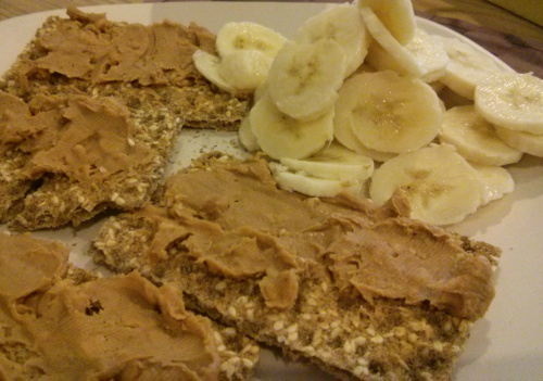 DIY Ryvita with peanut butter and thin slices of banana