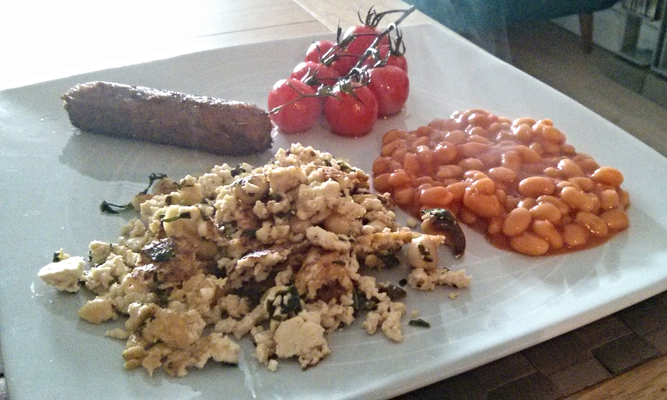 Scrambled tofu with tomatoes, beans and sausages