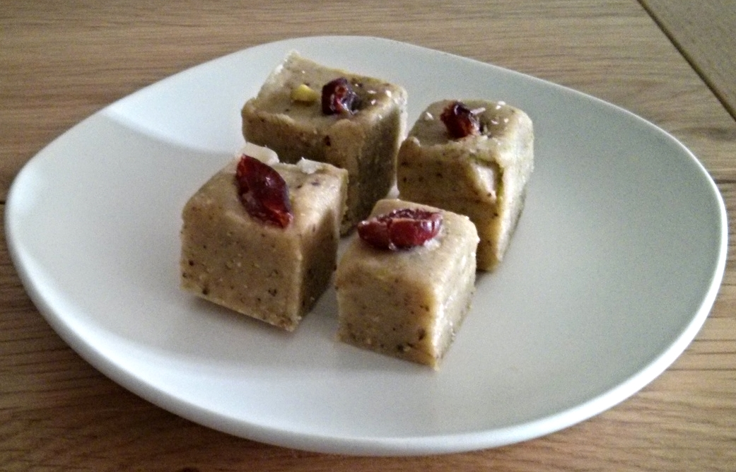 Pista Barfi garnished with dried cranberries