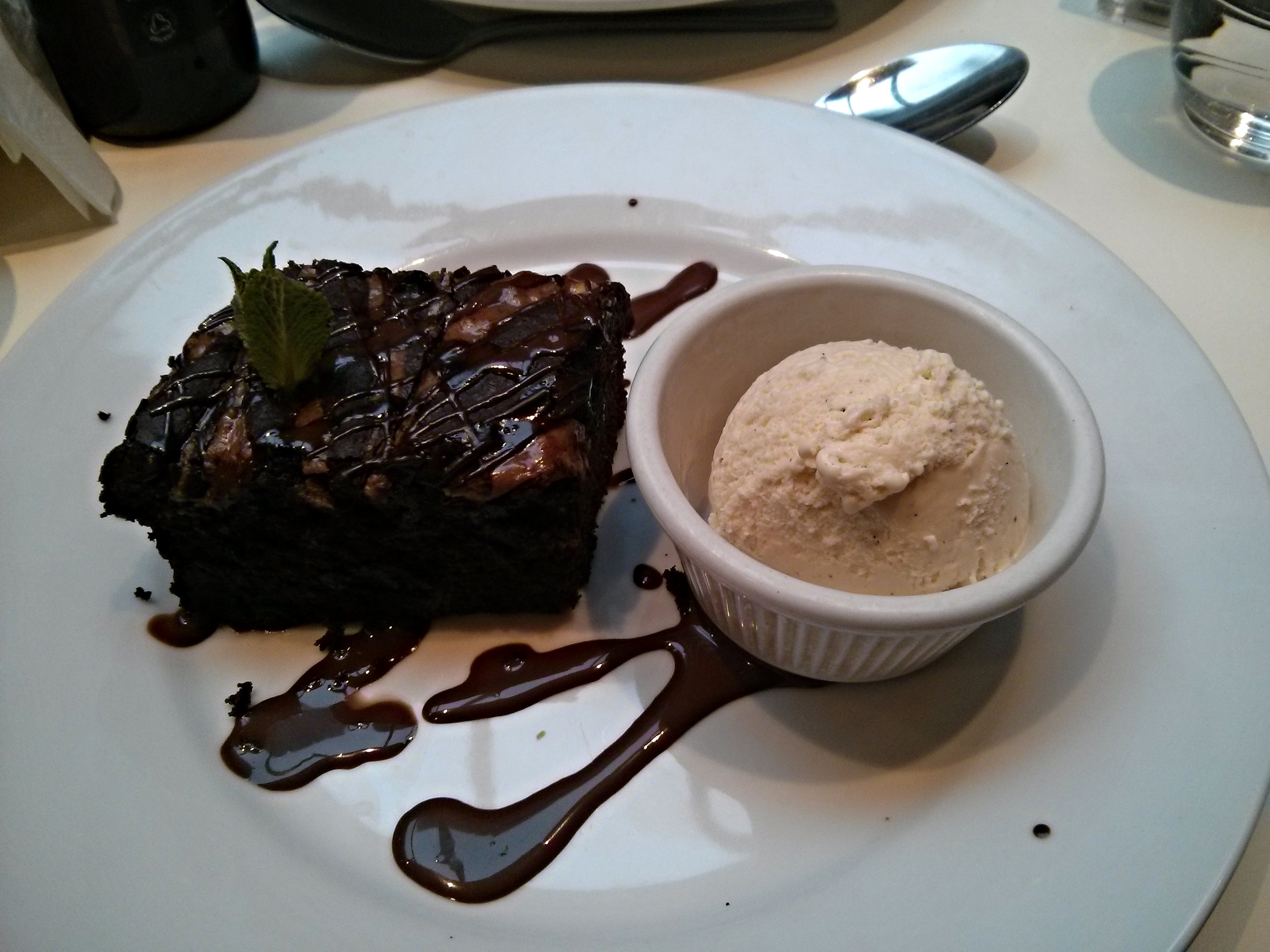 Chocolate and peanut butter brownie with chocolate sauce and vanilla ice cream