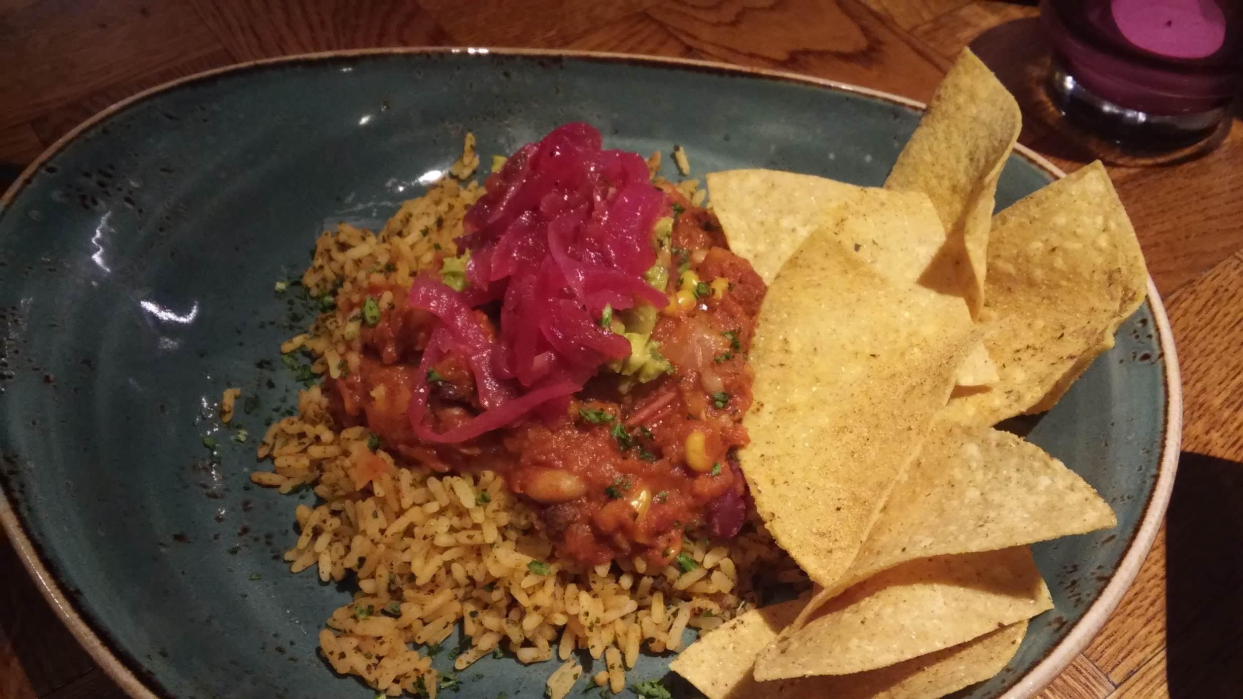 Veggie five bean chilli served with Mexican spiced rice, roasted vegetables and tortilla chips