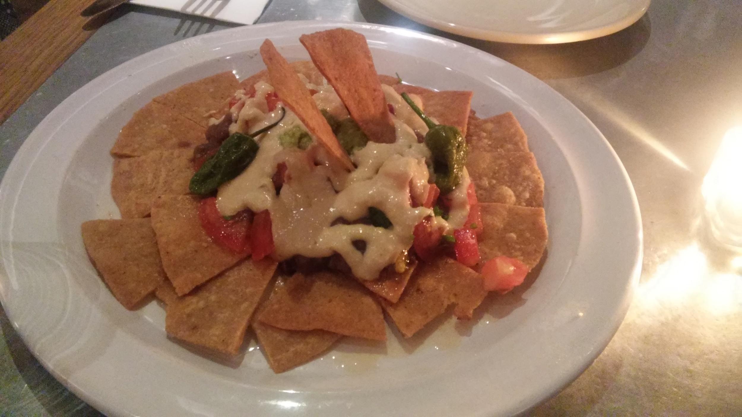 Ηealthy Nachos - Homemade no-fried corn and spelt nachos, adzuki beans stew, guacamole, fresh tomato dices, pimientos del padrón and vegan sour cream.