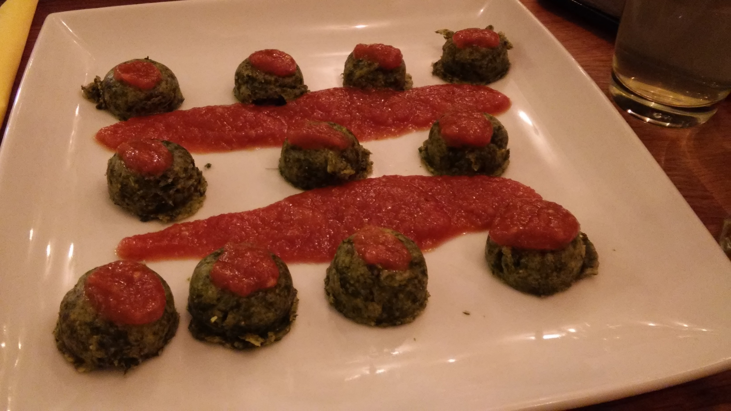 Polenta gnocchi with spinach and tomato sauce