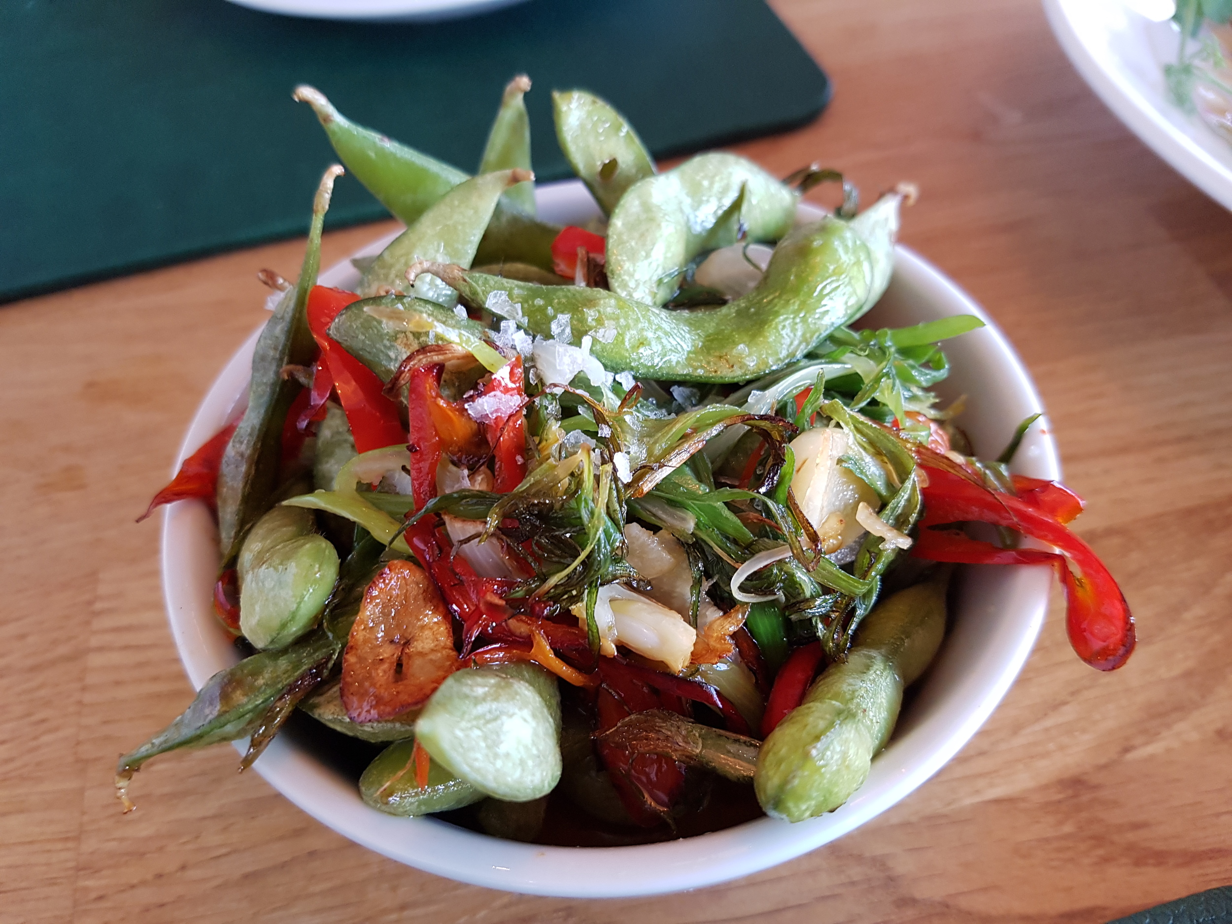 Edamame beans toasted in garlic, red chili and rock salt
