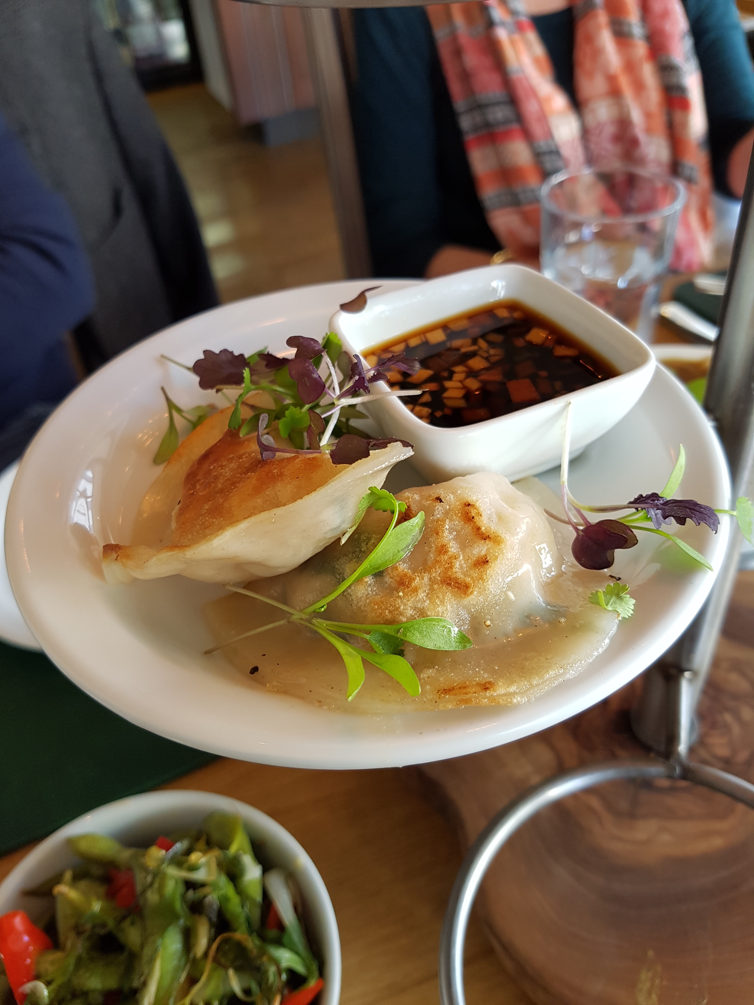 Gyoza filled with quinoa, tofu, peanuts and spring onions, served with Vietnamese dipping sauce