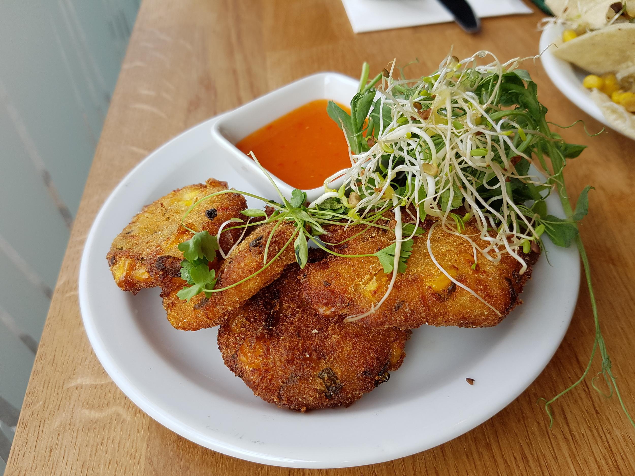 Thai cakes: potatoes, palm hearts, coriander, mooli, chilli, lemongrass, Thai paste served with sweet lime sauce