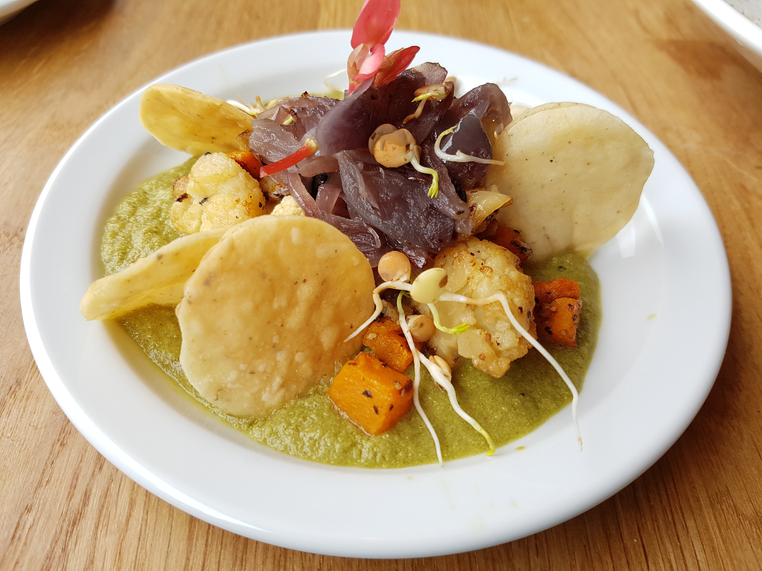 Pipian Mole: Green tomato and nut sauce, served with roasted squash and cauliflower, topped with caramelised onions