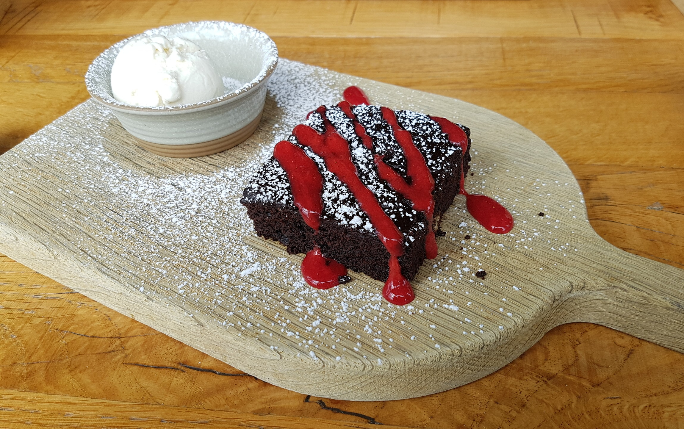 Vegan Brownie | with raspberry coulis and vegan ice cream
