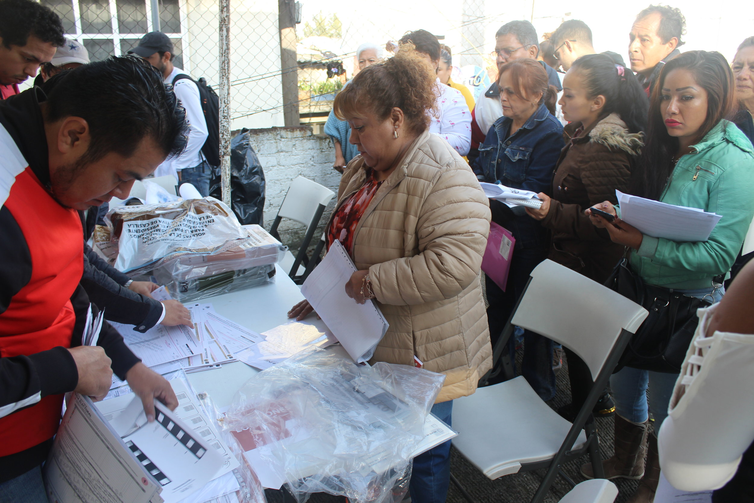 Political party representatives overseeing the electoral process at Jardin de Niños John Dewey, Tlalnepantla de Baz, Estado de Mexico, north of Mexico City.