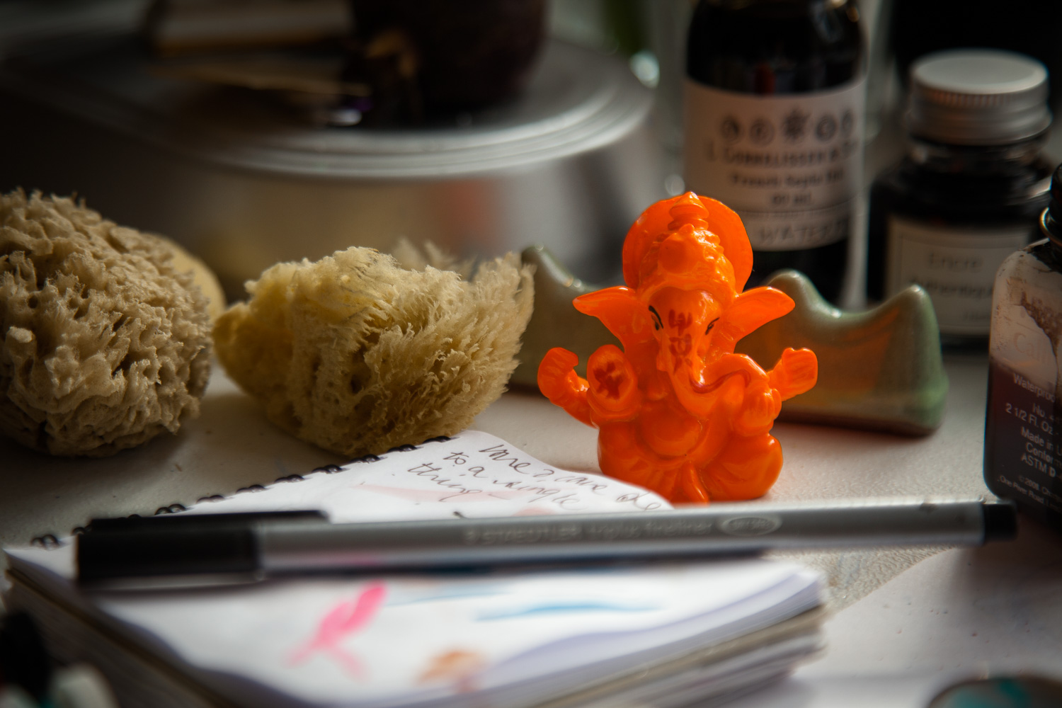 Working day begins with an offering prayer, thoughts and notes on a cluttered desk, ideas spill out amongst the chaos.